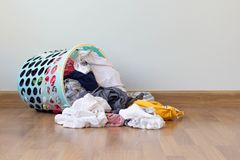 Free Pile Of Clothes Overflow Plastic Laundry Basket For Washing Preparations. Stock Image - 124266981