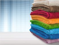 Pile Of Fluffy Towels On Wooden Table Stock Image