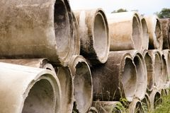 Free Pile Of Old And Dirty Cement Pipes Stock Image - 128303431