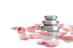 Pile Of Round Pebble Stone With Rose Petals Stock Photos