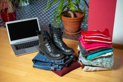 Free Pile Of Second Hand Clothing And Shoes With Computer On Floor Royalty Free Stock Photography - 139601597