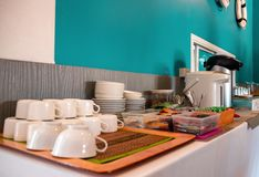 Free Pile Of Tea And Coffee Cups At A Buffet Breakfast Table Stock Images - 168022184