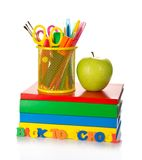 Pile Of Textbooks, Tools In Support And Apple Stock Photos