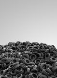 Pile Of Used Rubber Tyres On Gray Background Stock Photography