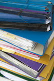 Pile of office binders in close up. Close up of pile of office bibders in different colors Royalty Free Stock Images