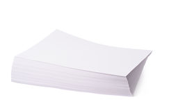 Pile of office paper sheets isolated. Pile of white office A4 format paper sheets isolated over the white background royalty free stock images