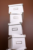 Pile of office storage boxes. Pile of white office storage boxes isolated on studio background Stock Photo