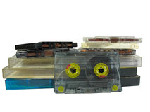 Pile of old audio cassetes isolated over white Stock Photos