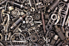 Pile of old bicycle parts and tools Stock Images