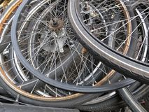 Pile of old bicycle wheels. With black silver colored speaks on a car Royalty Free Stock Image