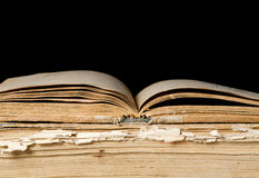 Pile of old books on black Royalty Free Stock Image