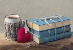 Pile of old books. Pile of old blue books and a cup of tea Royalty Free Stock Photo
