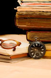 Pile of old books and different things Royalty Free Stock Photos