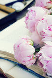 Pile of old books with flowers Stock Images