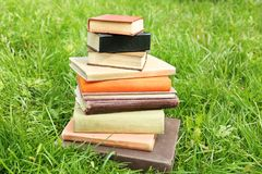 Pile of books on green grass. Pile of old books on green grass stock images