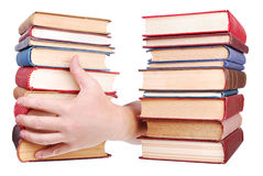 Pile of old books and hand stock photo