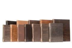 Pile of old books isolated on white background. Big stack of old antique books isolated on white background Stock Photo