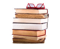 A pile of old books isolated on white background. Royalty Free Stock Image