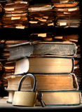 Pile of old books and keylock