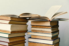 Pile of old books and an open book Royalty Free Stock Image