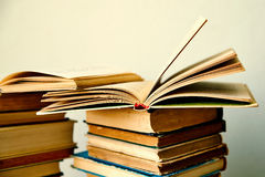 Pile of old books and an open book Royalty Free Stock Photo