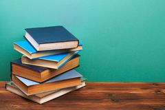 Pile of old books, panorma, good copy space  on blue background. Image stock photography