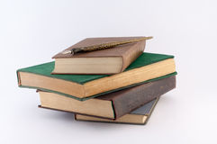 Pile of Old Books with Pen on Them. On a white background stock image