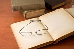 Pile of old books with reading glasses Royalty Free Stock Photo