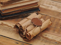 Pile of old books and scroll Royalty Free Stock Image