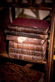 A pile of old books on a shelf Royalty Free Stock Photos