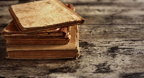 Pile of old books. Top view of ancient books on wooden table stock photography