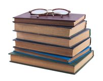 Pile of old books and vintage glasses Royalty Free Stock Photography