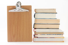 Pile of old books with wooden message board.  Stock Photography