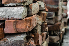 Pile of old bricks. Old broken bricks with cement residues Royalty Free Stock Image