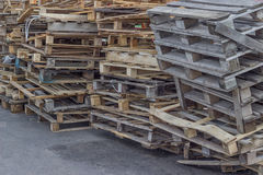 Pile of old and broken wooden pallets. Outdoor Royalty Free Stock Images