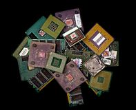 Pile of old burned CPU chips and memory modules. Close view royalty free stock photo