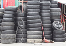 Pile of old car tires. In industrial Stock Photography