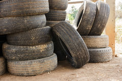 Pile of old car tires for rubber recycling. Stack of old car tires for rubber recycling royalty free stock photo