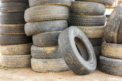 Pile of old car tires for rubber recycling. Stack of old car tires for rubber recycling stock image