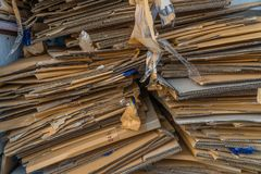 Pile of old cardboard boxes for recycling royalty free stock photo