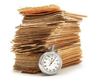 Pile of old cards with stopwatch Royalty Free Stock Images