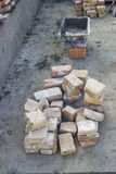 Pile of old clay bricks and cement mortar trowel for building Stock Image