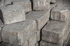 Pile of old concrete bricks stock image