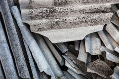 Pile of the old and damaged wavy roofing slates Stock Photo