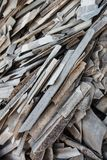 Pile of the old and damaged wavy roofing slates Royalty Free Stock Images