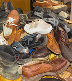 Pile of old different worn footwear Royalty Free Stock Image