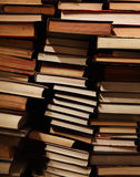 Pile of old dirty books on book shelf Stock Image