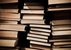 Pile of old dirty books on book shelf Royalty Free Stock Images