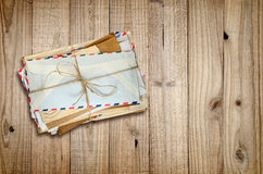 Pile of old envelopes on wood Royalty Free Stock Photo