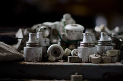 Pile of old fuses. On dusty rusty surface Stock Image